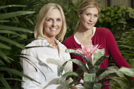 Greenhouse : Portrait of a young daughter with senior mother in botanical garden