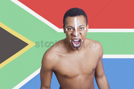 Respect : Portrait of aggressive mixed race man against south african flag