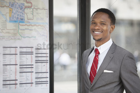 Businessmen : Portrait of an african american young businessman smiling