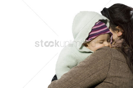 Offspring : Portrait of beautiful mother holding baby girl against white background