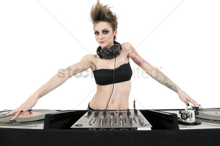 Fashion : Portrait of beautiful young female dj wearing strapless lingerie over white background