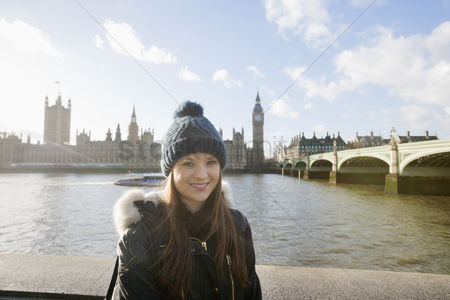 England : Portrait of beautiful young woman standing by river thames  london  uk