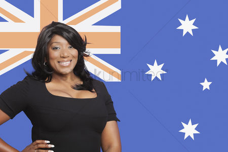 Respect : Portrait of casual mixed race woman against australian flag