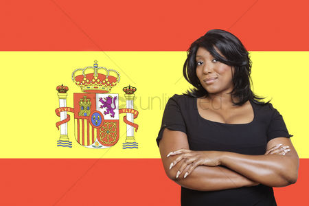 Respect : Portrait of casual mixed race woman against spanish flag