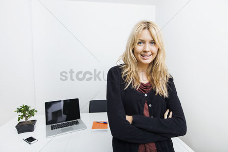 Camera : Portrait of confident businesswoman in office