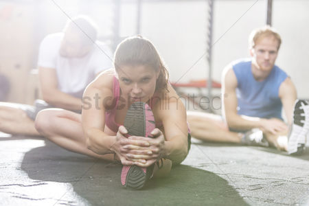 Fitness : Portrait of confident woman exercising in crossfit gym