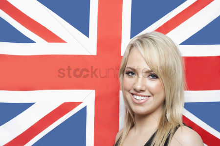British ethnicity : Portrait of happy young woman against british flag