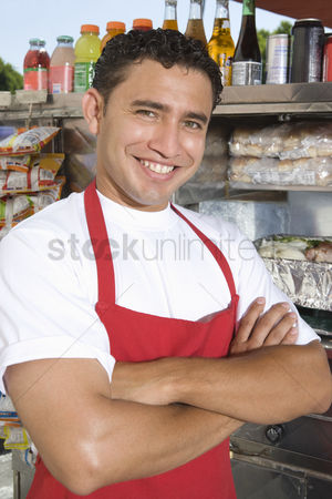 Apron : Portrait of male street vendor by stall