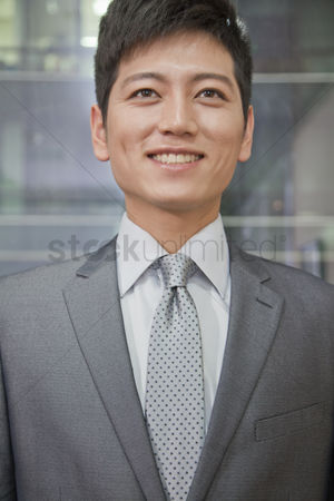 Proud : Portrait of smiling businessman
