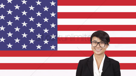 Respect : Portrait of young businesswoman smiling over american flag