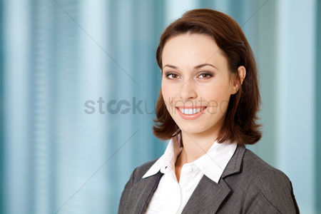 Happy : Portrait of young caucasian businesswoman in office