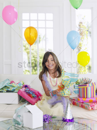 Birthday present : Portrait of young girl  7-9  with birthday presents smiling