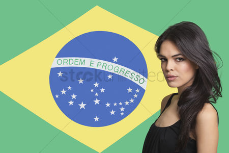Respect : Portrait of young woman against brazilian flag