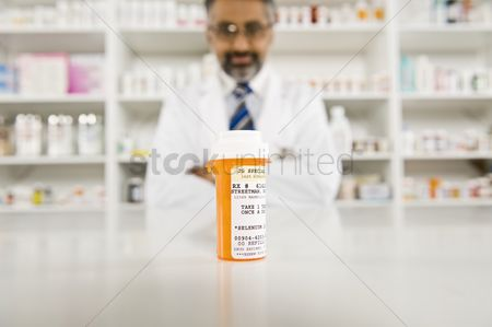 Medication : Prescription drugs and male pharmacist