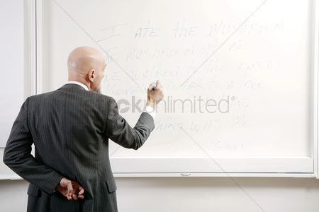 Bald : Professor writing on the white board