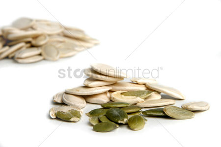 Collection : Pumpkin seeds on whote background