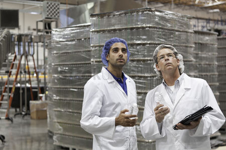Pile : Quality control workers inspecting at bottling plant