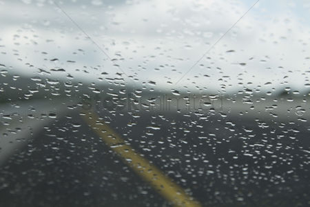 On the road : Rain drops on the windshield of a car  dublin  republic of ireland
