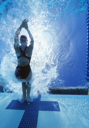 Swimmer : Rear view of female swimmer in competition