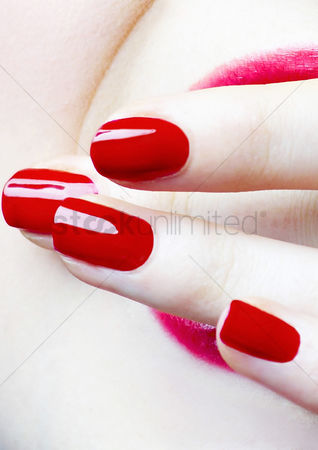 Finger : Red coloured finger nails