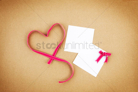 Heart shapes : Ribbon forming a heart shaped with paper notes