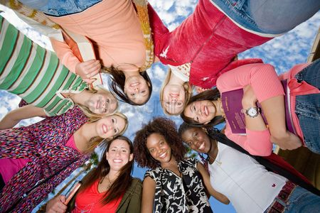 High school : Ring of female friends outdoors  portrait