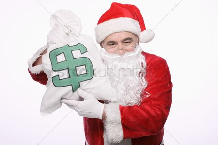 Dollar sign : Santa claus with a bag of money