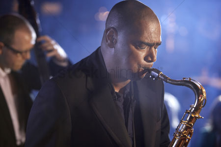 Bald : Saxophone player on stage portrait