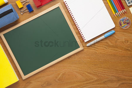 Notepad : School supplies on desk background with copy space