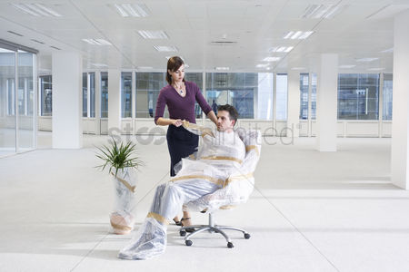 Office worker : Secretary wrapping businessman