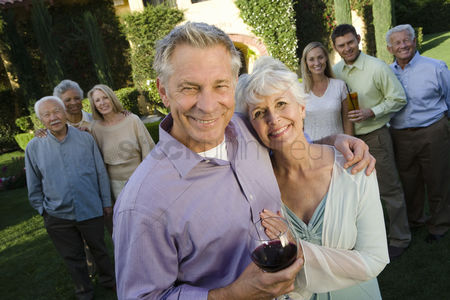 Senior women : Senior couple celebrating with family and friends in garden