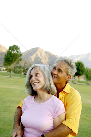 Relationship : Senior couple embracing in the park