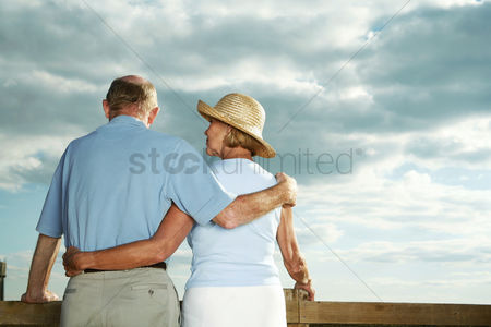 Lady : Senior couple enjoying beautiful field scenery
