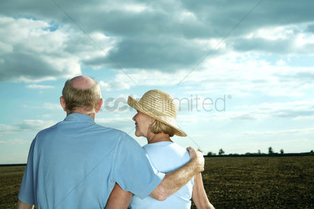 Two people : Senior couple enjoying beautiful field scenery