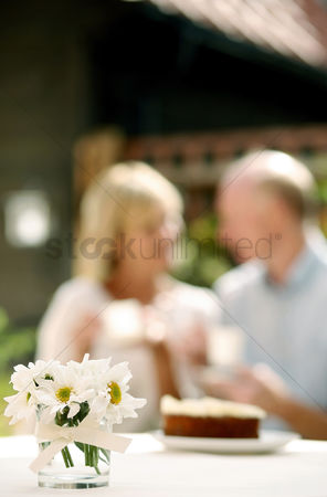 Aging process : Senior couple enjoying teatime together