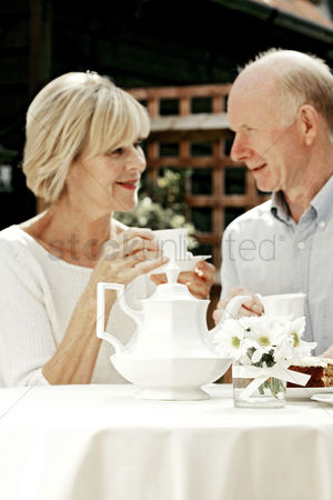 Lover : Senior couple having teatime together