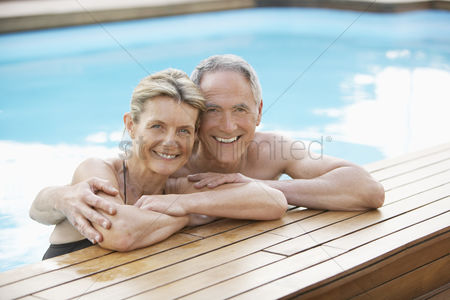 Lady : Senior couple relaxing in swimming pool