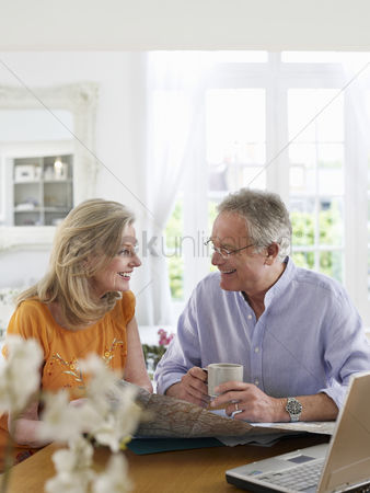 Sitting on lap : Senior couple sitting at dining table