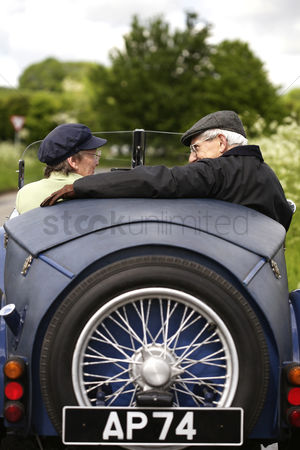 Bespectacled : Senior couple traveling in the car