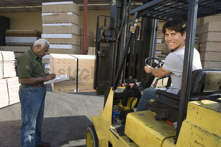 Forklift : Senior warehouseman and mid-adult forklift truck driver
