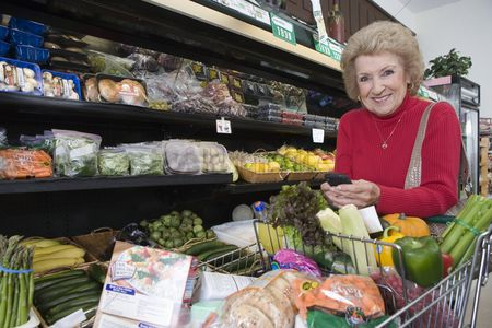 Shopping cart : Senior woman grocery shopping