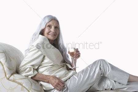Food  beverage : Senior woman having glass of champagne