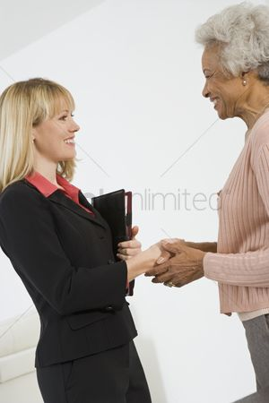 Advice : Senior woman meeting financial advisor