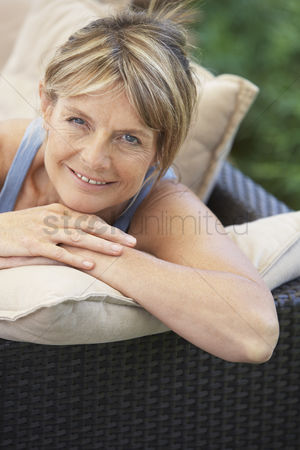 Gaze : Senior woman relaxing in garden