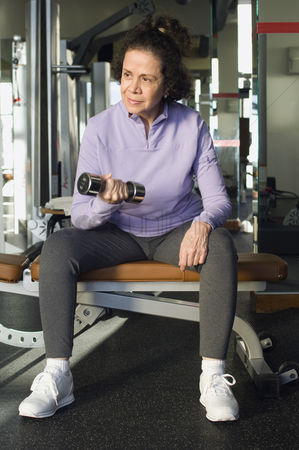 Dumbbell : Senior woman weightlifting with dumbbell