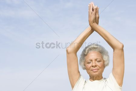 Retirement : Senior woman with eyes closed in yoga pose