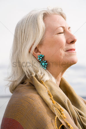 Bliss : Serene looking gray haired woman