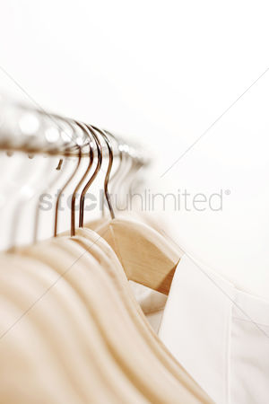 Conceptual : Shirt hanging on rack