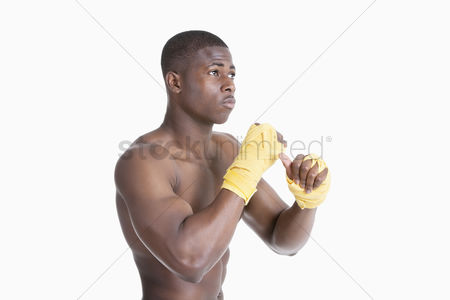 Arts : Shirtless african american kickboxer over gray background