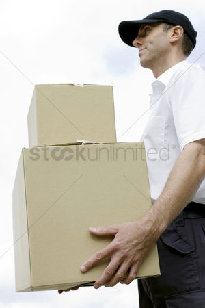 Strong : Side view of a delivery man on duty